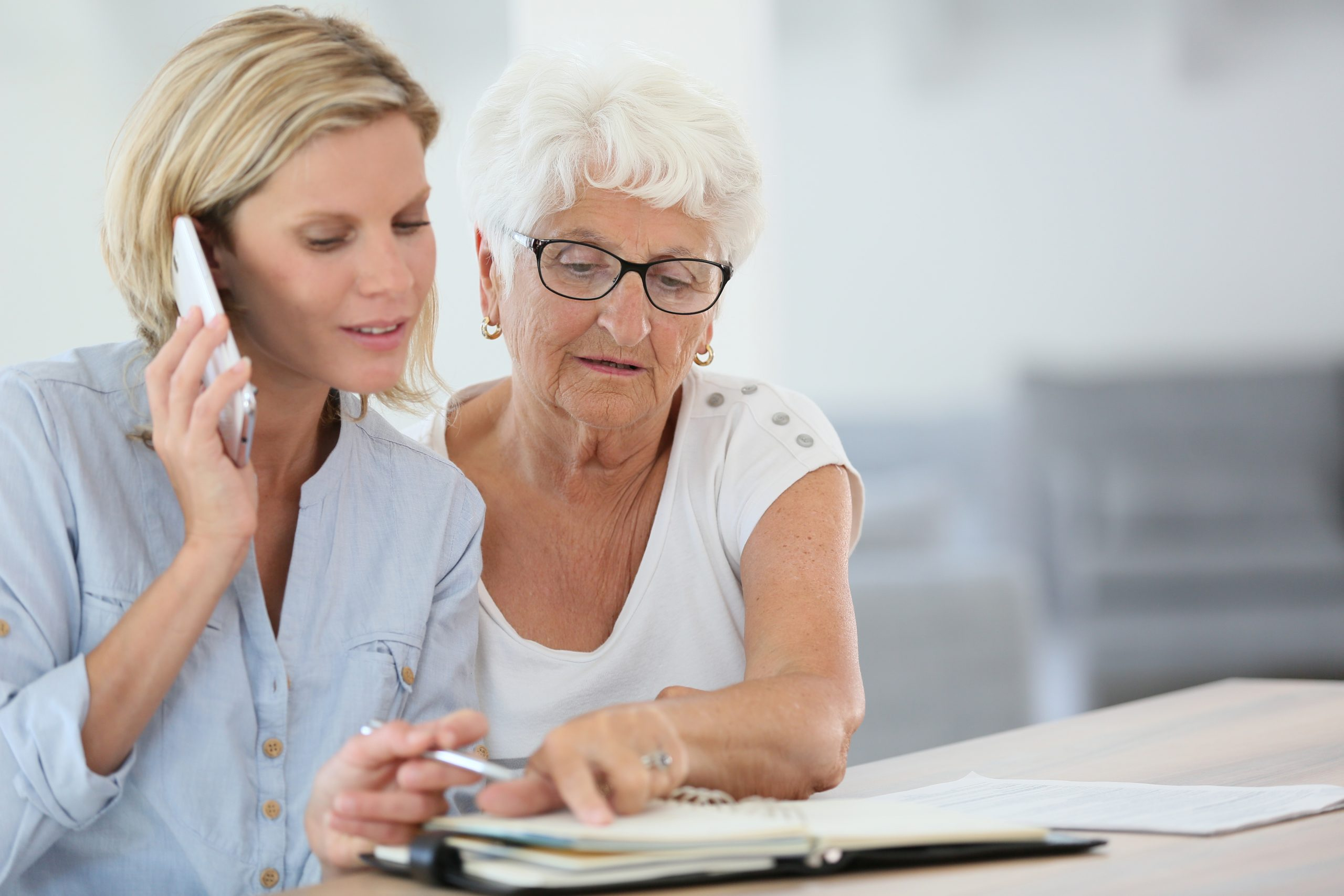 Homehelp booking medical appointment for elderly woman